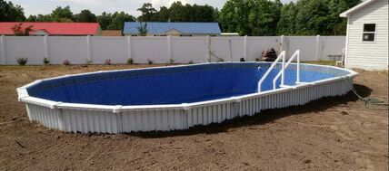 aquasport 52 pool partially buried ready for deck in North Carolina